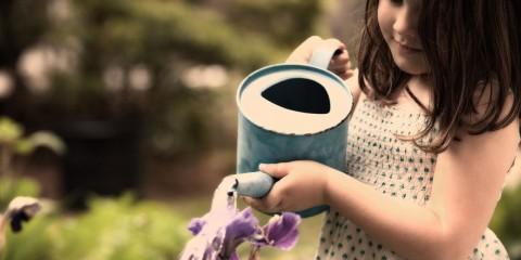 Child-Girl-Watering-Flowers-768x1280