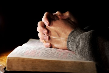 praying-hands-on-bible_converted