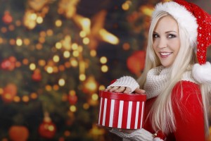 7012842-christmas-tree-santa-claus-blonde-girl-smile-gift-winter