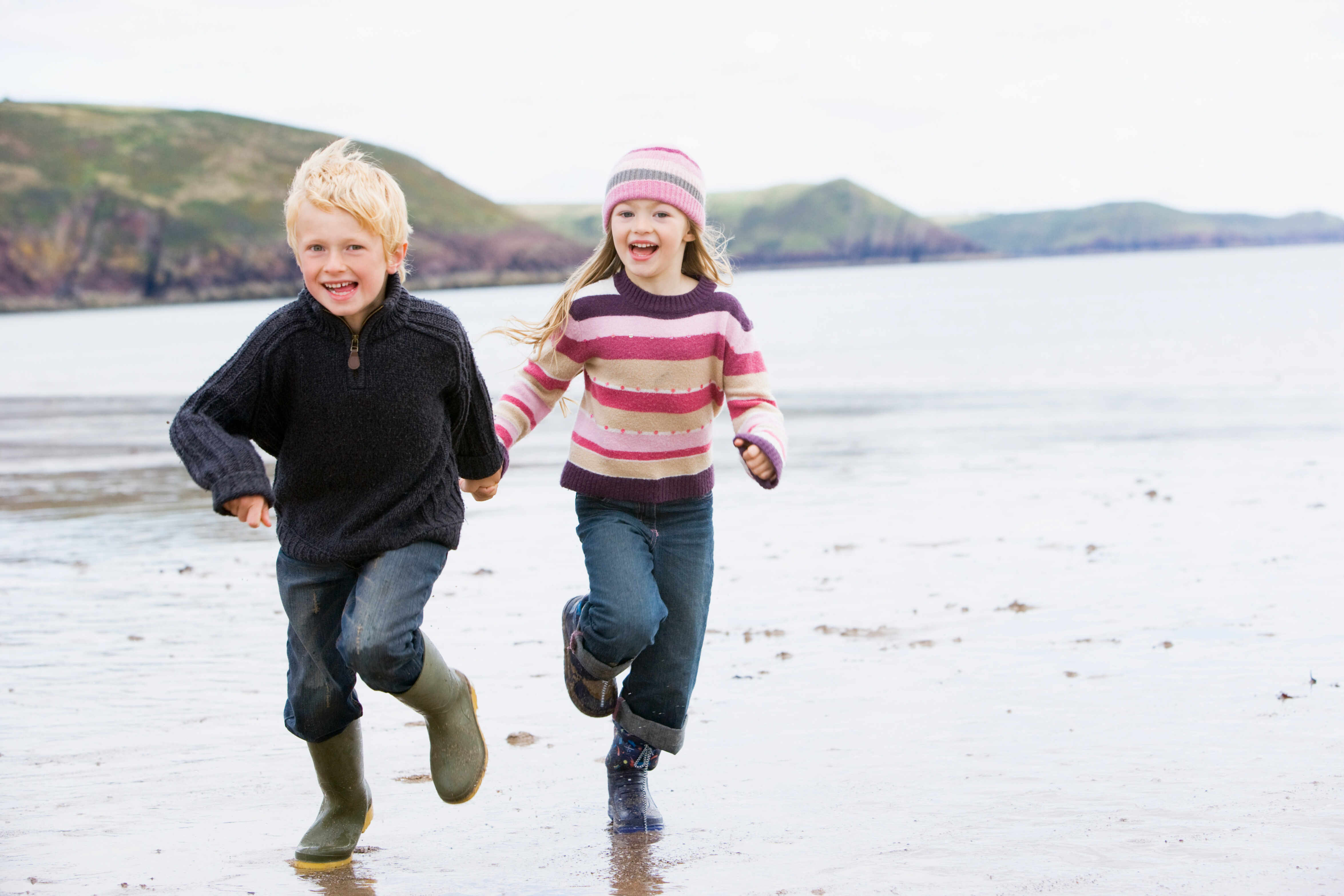 children-running-on-beach