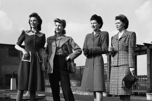 At a famous west end store, Norman Hart Nell, Britain's leading dress designer, sponsored a show of the new utility fashions for the coming season on March 9, 1943. These models, said Mr. Hartnell, are designed not only for the home market but also to uphold Britain's fashion prestige abroad. From Left to right are: a 2-tone blue frock by Frances Leopold with unusual model pockets; navy blue Jaeger slacks with camel-coloured duffle coat and a wool-taffeta check blouse, a moss green coat with full yoke and inset belt with balanced pockets. (**Caption information received incomplete) (AP Photo)