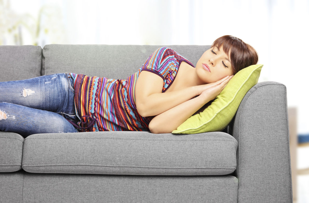 Woman-napping-on-couch