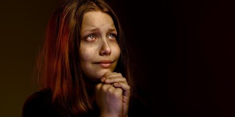 Desperate lonely teen girl praying