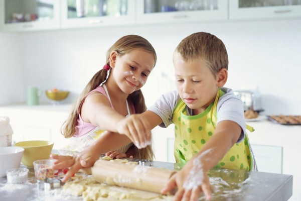 Children making biscuits --- Image by ?? Royalty-Free/Corbis