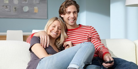 couple-laughing-at-home