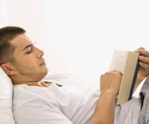 man-reading-book-in-bed--393d0
